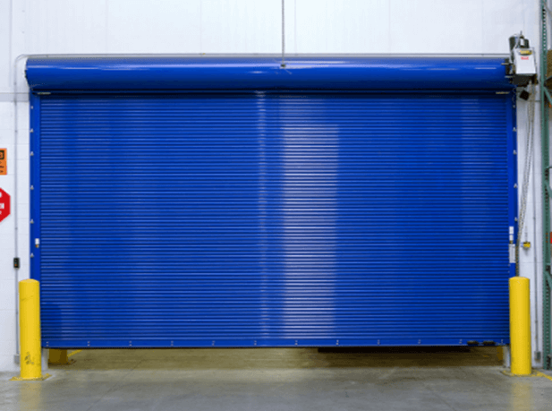 Rolling steel door (firewall) used to divide 2 areas in a manufacturing business.