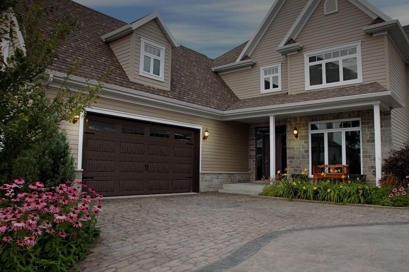 Traditional 2-stories house. Garage door is a North Hatley LP, 16' x 8', Moka Brown color, 4 vertical lite Orion windows