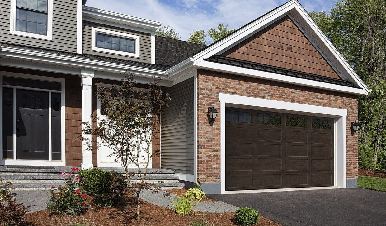 Brick and cedar shingle 2-story house with a Regal Shaker‑Flat Long design, 16'x8', Dark Walnut, windows with Richmond Inserts garage door
