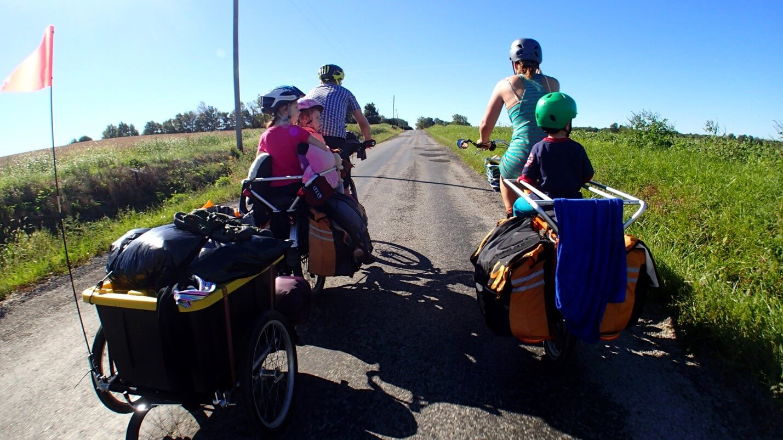 Family biking on a country lane.