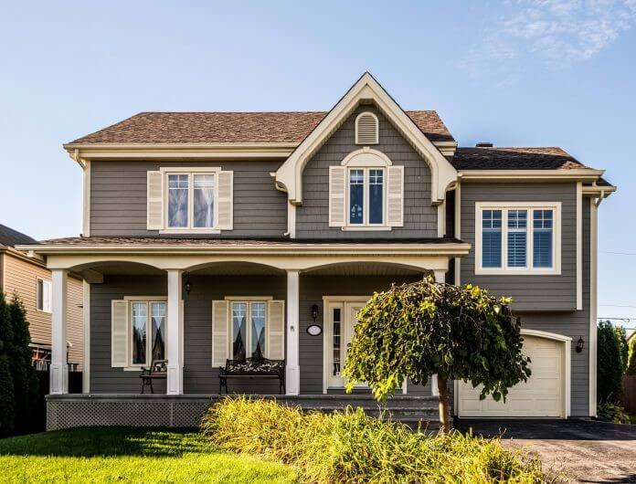 A traditional home gets a second floor over its garage. Great results!