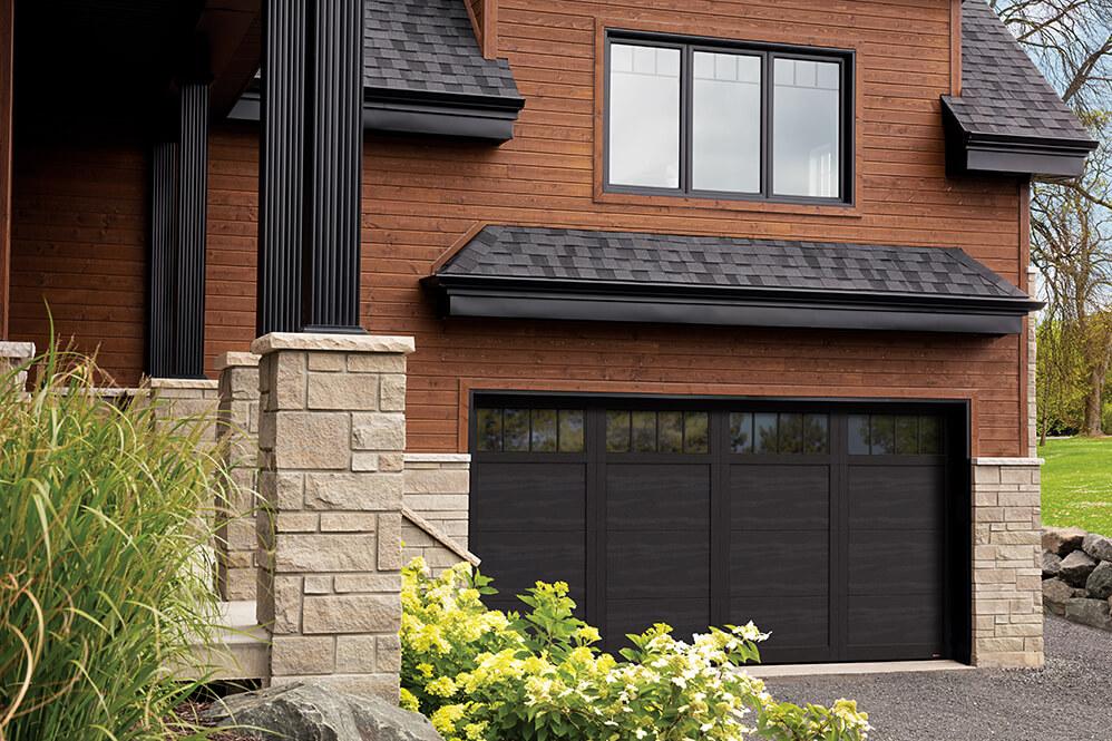 Prestigious house with a double garage door in Eastman E-11 design, Black door and overlays, and panoramic windows