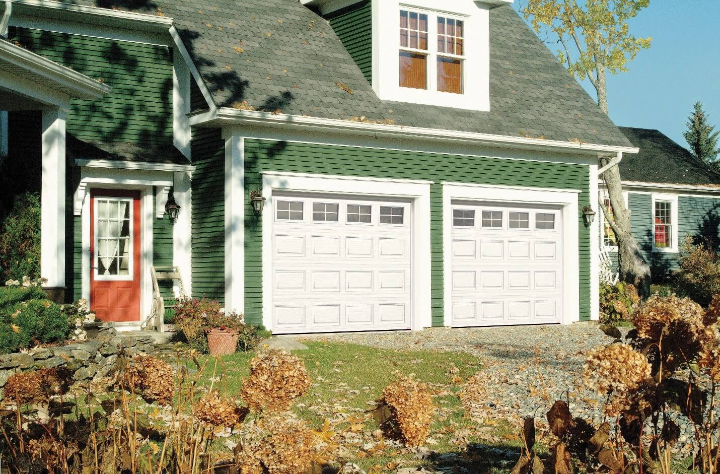 Country style house with 2 single garage doors in Classic CC design, Ice White color, and 4 lite Orion windows