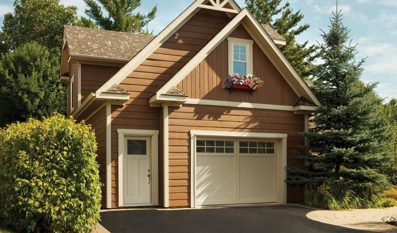 Garage Door: Eastman E-11, 10' x 7', Desert Sand door and overlays, 8 lite Panoramic windows