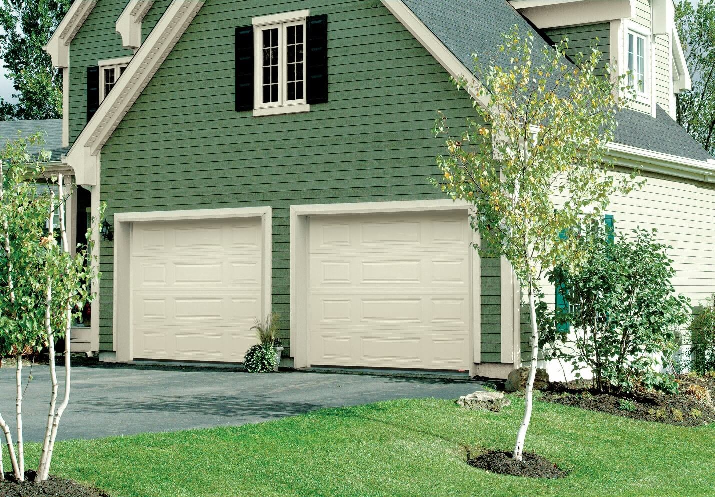 You like this look? These are Standard+ Classic MIX Design, 9' x 7', in Desert Sand Color garage doors