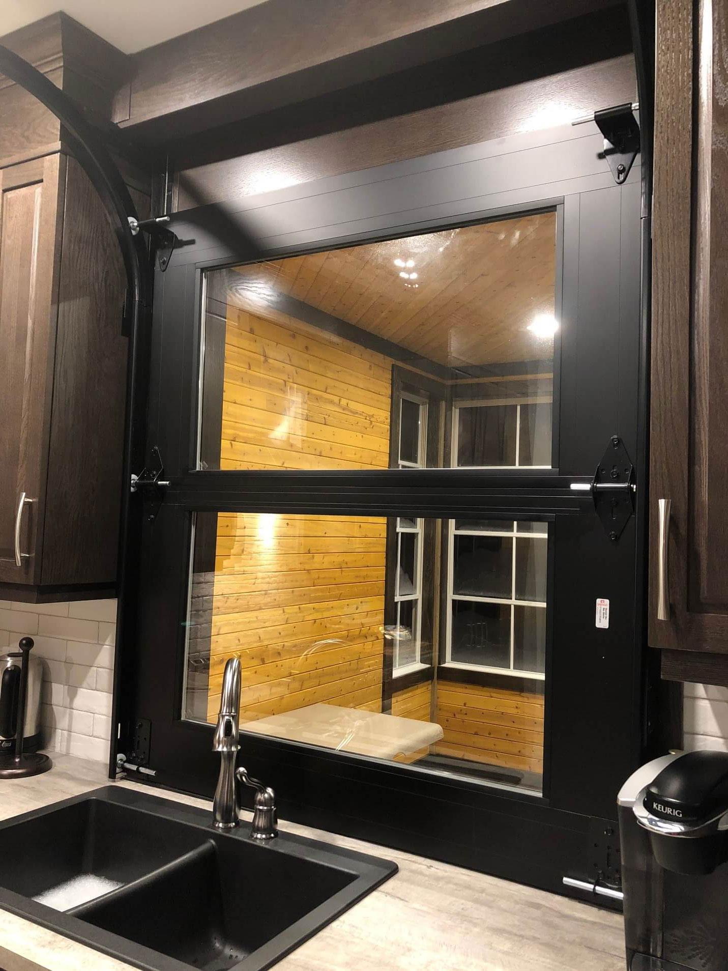 The California garage door over a kitchen sink. Inside of the door from the kitchen