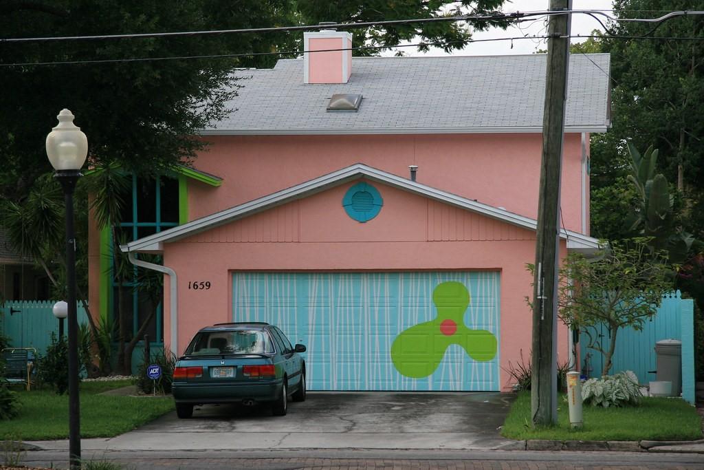 Pink house with colored garage door