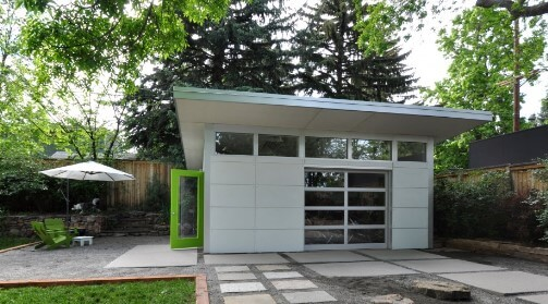 She shed with an all-glass garage door