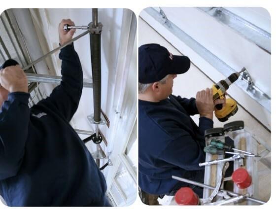Garage door specialist installing a spring