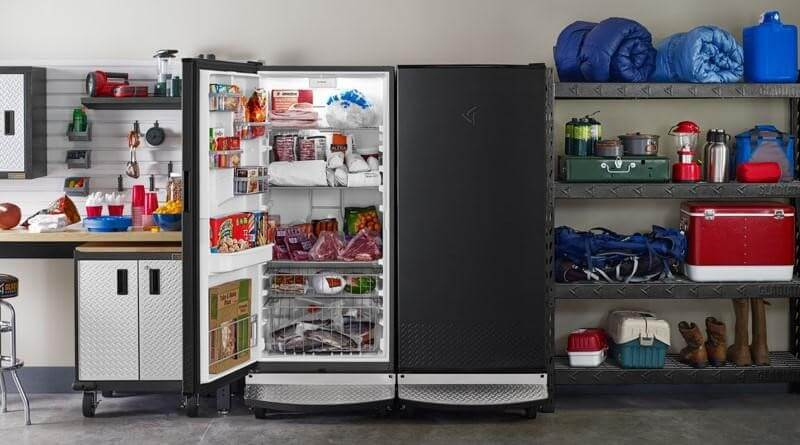 Big freezer with an open door in a garage