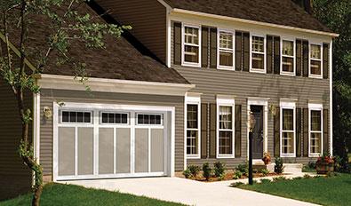 Garage doors in Kawartha Lakes Region - Eastman E-12, 14' x 7', Claystone door and Ice White overlays, 4 vertical lite Orion windows